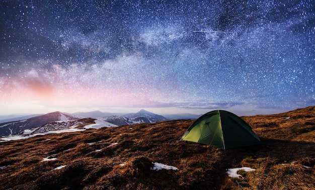 The starry sky above the tent in the mountains. Premium Photo