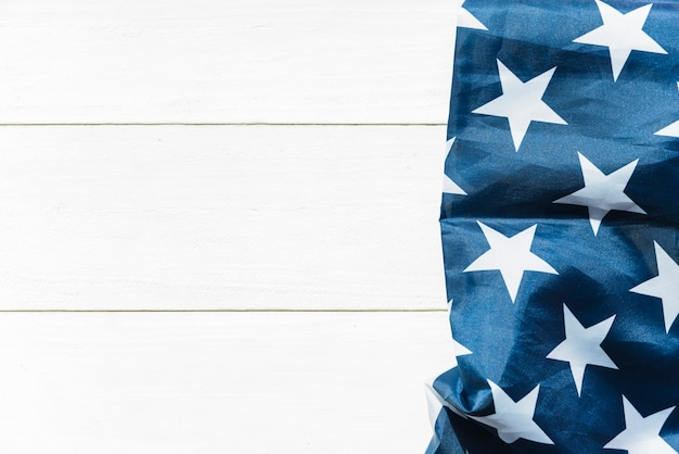 Stars on blue cloth on striped surface Free Photo