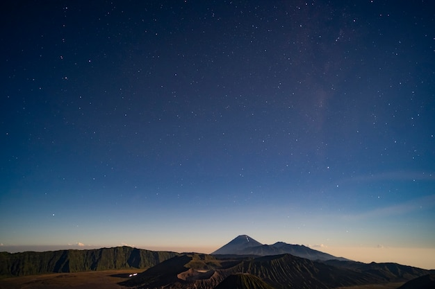 The stars in the night at the magnificent volcano bromo is a foreground Premium Photo