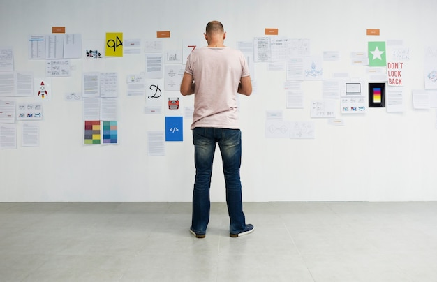 Startup business people looking on strategy board information thoughtful Free Photo