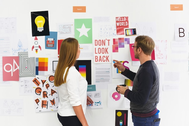 Startup business people looking on strategy board information thoughtful Premium Photo