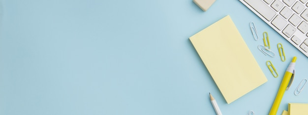 Stationary composition on blue background with copy space Premium Photo