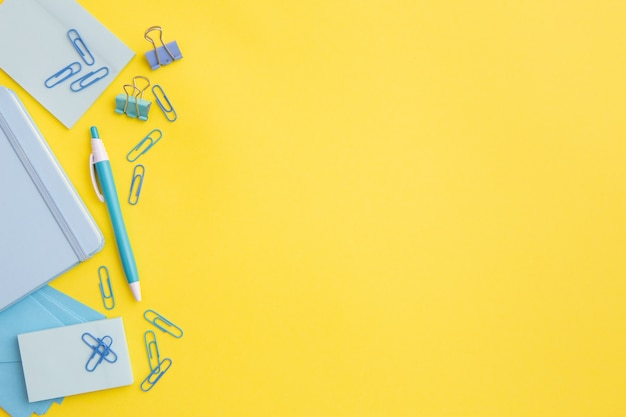 Stationary composition on yellow background with copy space Free Photo