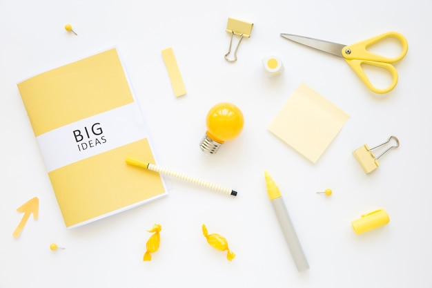 Stationeries, bulb, and candies with big ideas diary Free Photo