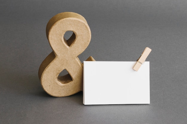 Stationery concept with business card and ampersand Premium Photo