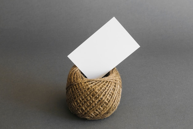 Stationery concept with business card on rope Premium Photo