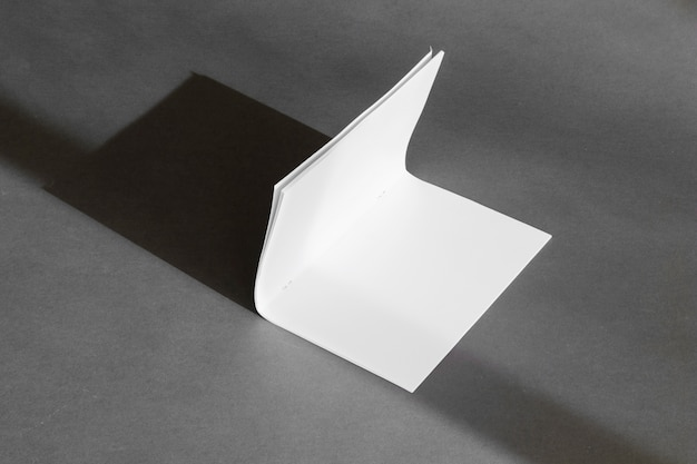 Stationery concept with folded paper sheet Free Photo