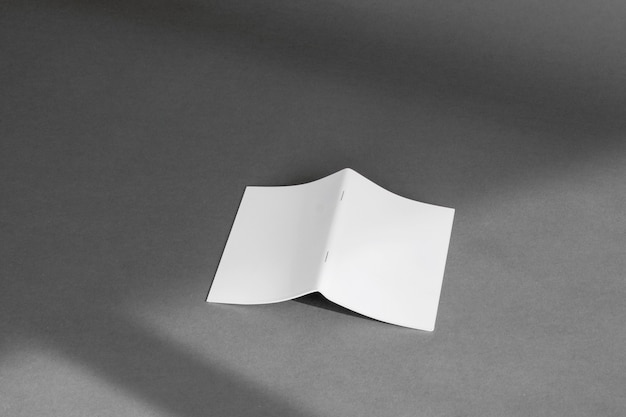 Stationery concept with sheet of folded paper Free Photo