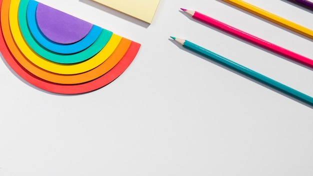 Stationery concept with sticky notes and rainbow paper Free Photo