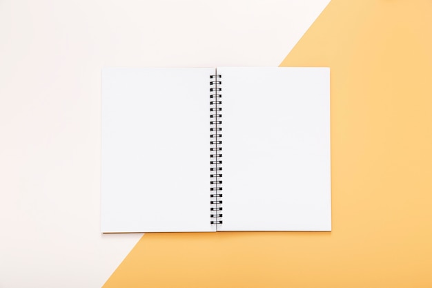 Stationery elements with empty opened notepad Free Photo