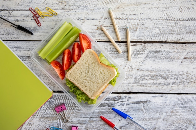 Stationery and lunchbox on table Free Photo