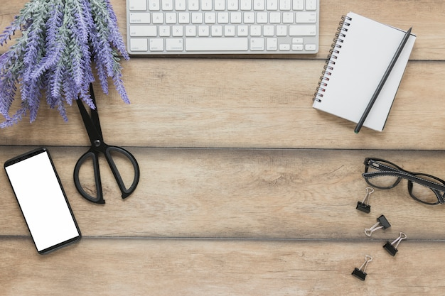 Stationery near electronic devices and lavender flowers on desk Free Photo