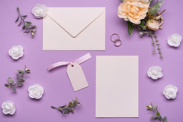 Stationery wedding invitation with flowers Free Photo