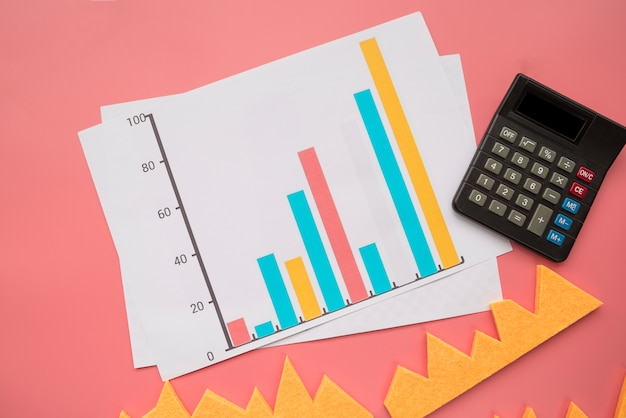 Statistic graphic with calculator Free Photo