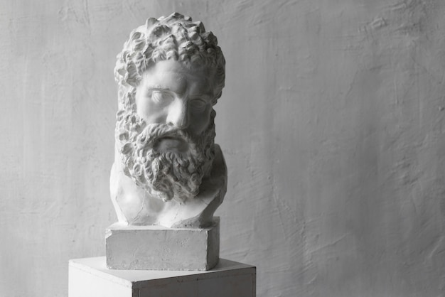 Statue of greek god in artist studio Free Photo