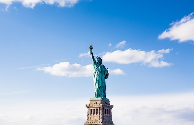 The statue of liberty with cloudy beautiful sky Free Photo