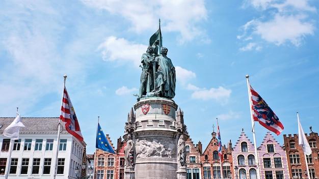 The statue in the market square in bruges belgium Premium Photo