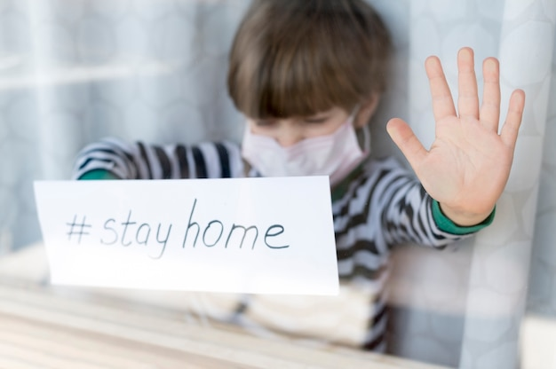 Stay home child wearing a mask Free Photo