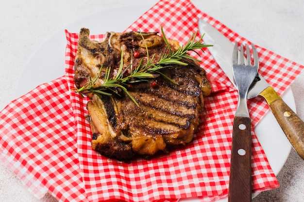 Steak decorated with rosemary Free Photo