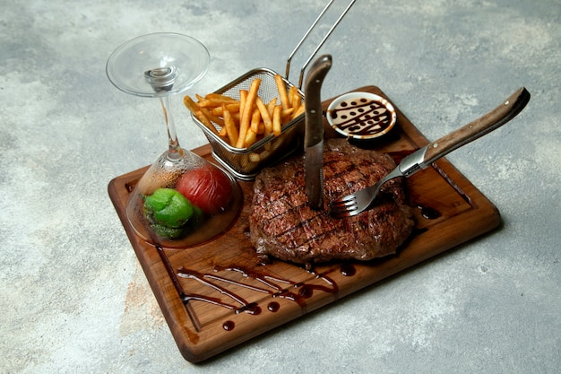 Steak with fries and vegetables Free Photo