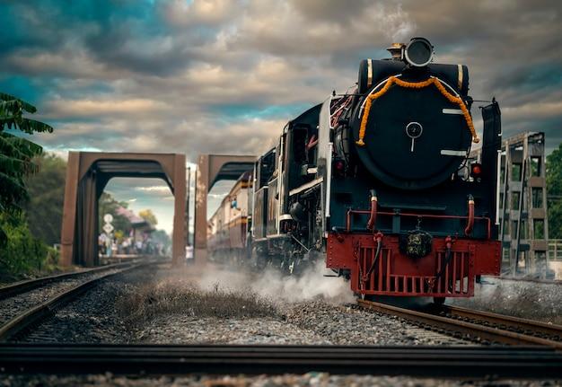 Steam locomotive trains depart from ayutthaya station to promote domestic tourism in phra nakhon si ayutthaya, thailand Premium Photo