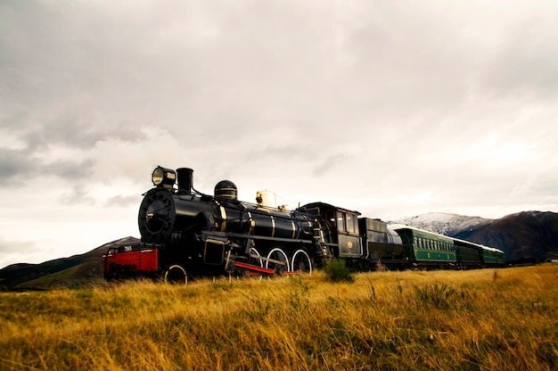 Steam train in a open countryside. Free Photo