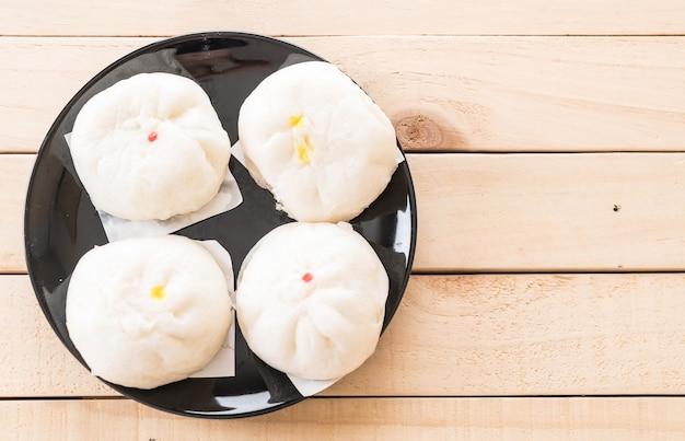 Steamed dumpling or chinese bun Free Photo
