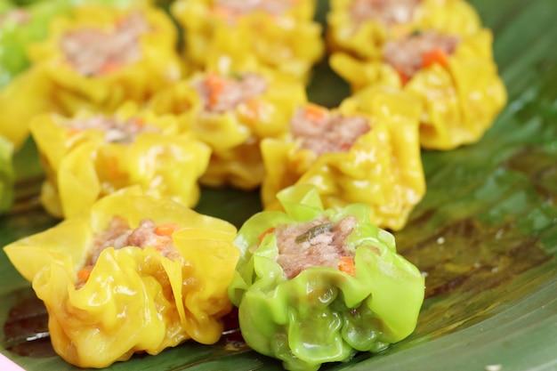 Steamed dumplings at street food Premium Photo