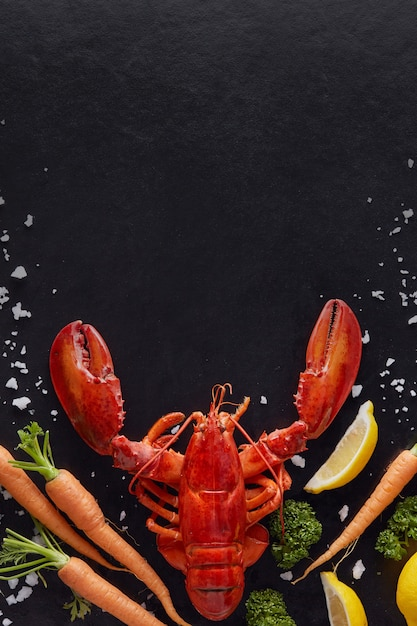 Steamed lobster prepared on black background with copyspace Premium Photo
