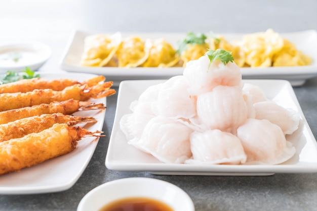 Steamed shrimp dumplings dim sum Free Photo