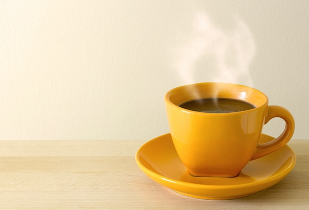 steaming coffee cup on table Free Photo