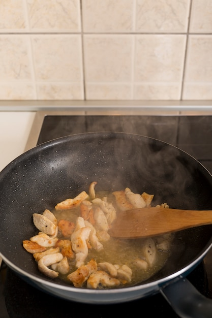 Steaming food in the frying pan Free Photo
