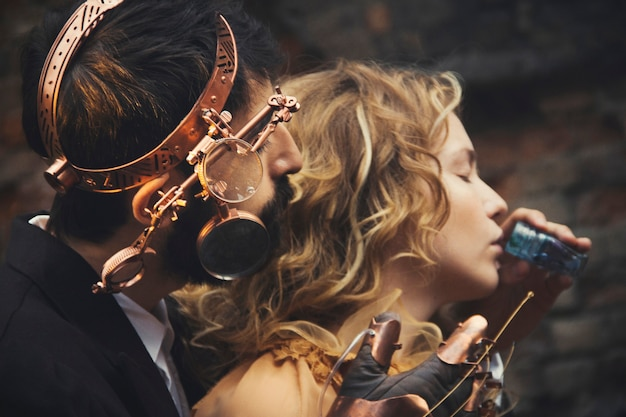 Steampunk fairy tale magic of a couple in love. the love story of men and women Premium Photo