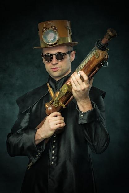 Steampunk man in a hat with gun Premium Photo