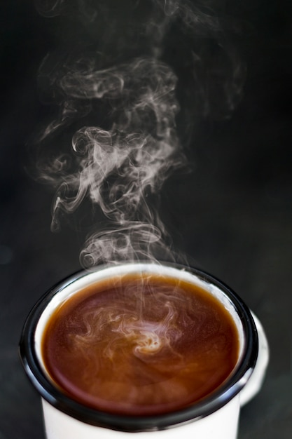 Steamy coffee with milk in cup Free Photo