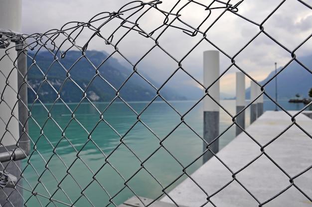 Steel fences around the sea pier, background Premium Photo