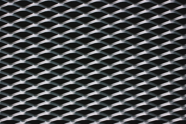 Steel wire mesh grille at the front of the building. black and white texture Premium Photo