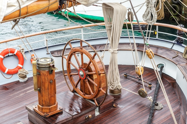 Steering wheel for captain on an old sailboat. sines Premium Photo