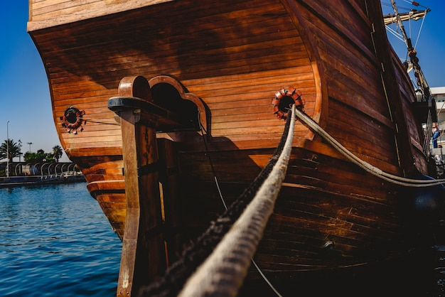 Stern of old galley docked in port to navigate the ocean in the discovery of america. Premium Photo