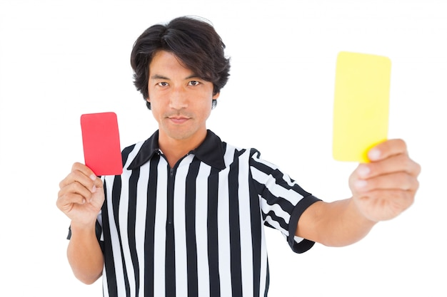 Stern referee showing yellow card Premium Photo