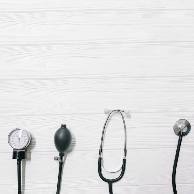 Stethoscope and pulsimeter on wooden table Free Photo