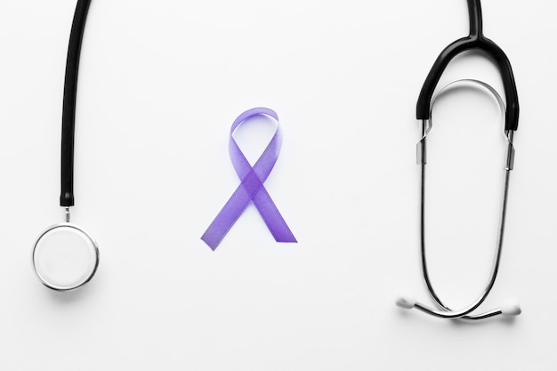 Stethoscope and violet ribbon Free Photo