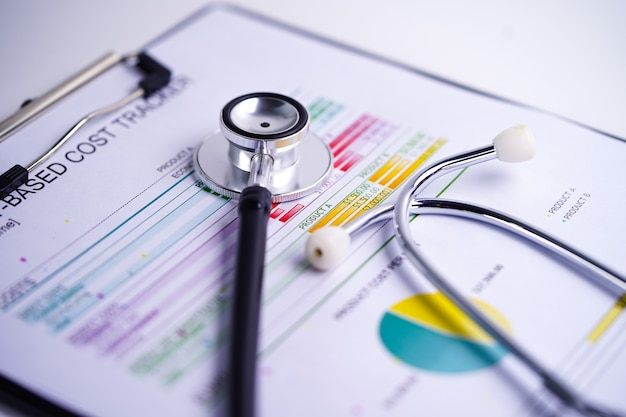 Stethoscope on charts or graphs paper Premium Photo