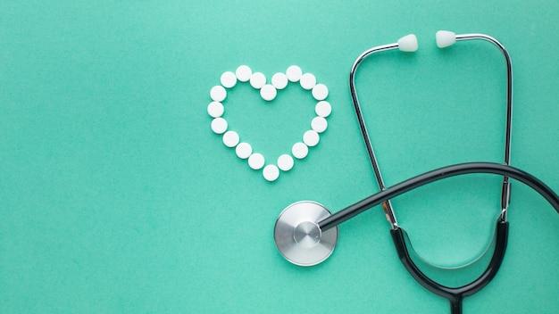 Stethoscope and pills flat lay Free Photo