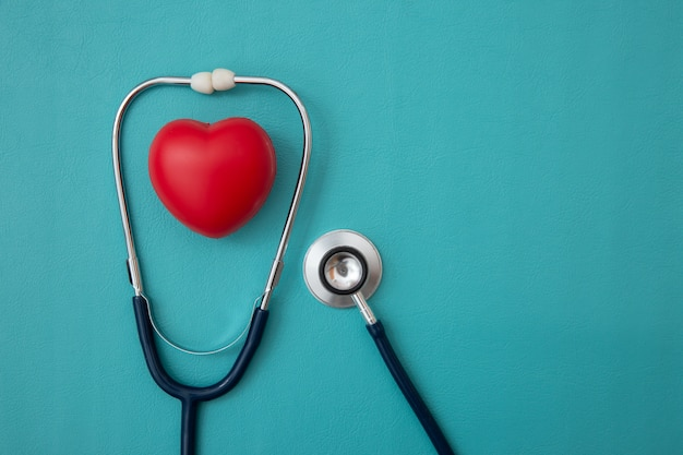 Stethoscope and red heart heart check on blue Premium Photo