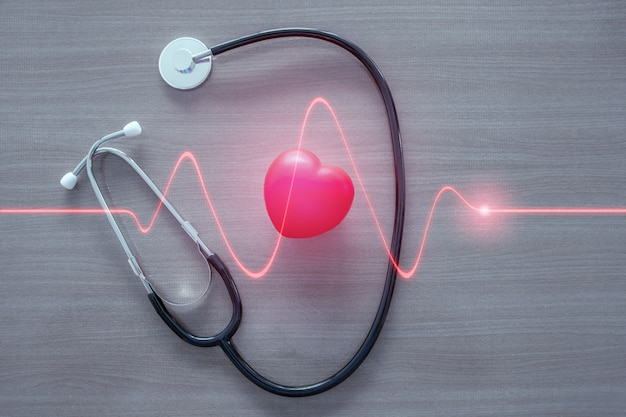 Stethoscope and red heart with glowing red heart wave. Premium Photo