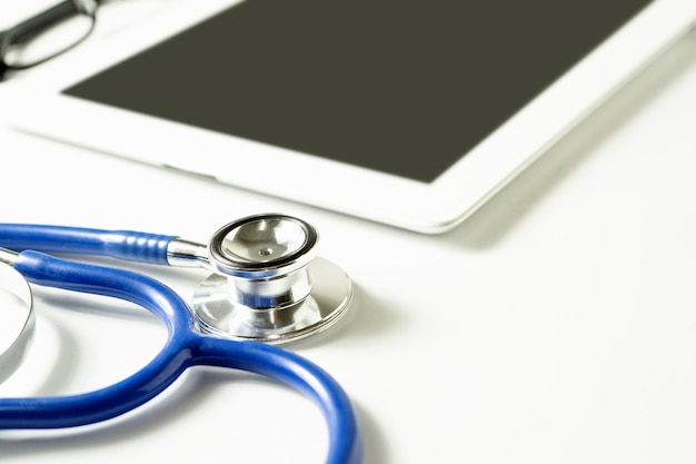 Stethoscope with tablet working space of doctor for consultan Premium Photo