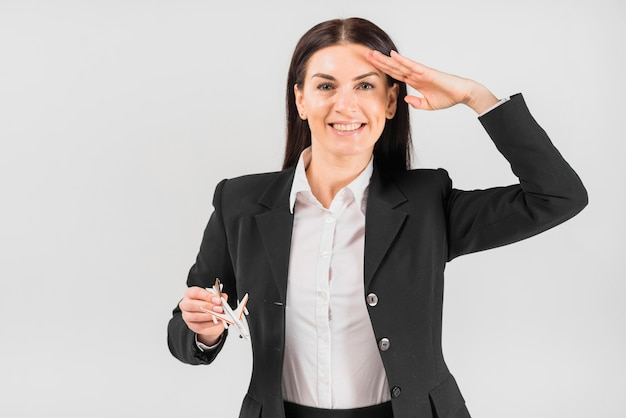 Stewardess with plane saluting Free Photo