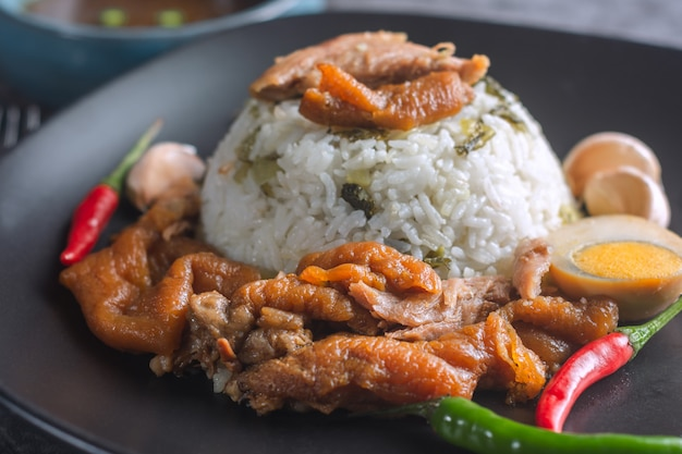 Stewed pork leg on rice thai recipe. Premium Photo