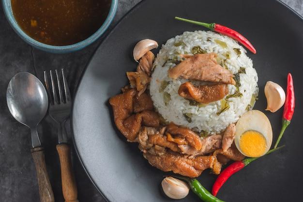 Stewed pork leg on rice with sauce thai recipe. Premium Photo